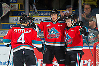 KELOWNA, BC - NOVEMBER 8: Devin Steffler #4, Alex Swetlikoff #17 and Michael Farren #16 of the Kelowna Rockets celebrate a second period goal against the Medicine Hat Tigers  at Prospera Place on November 8, 2019 in Kelowna, Canada. (Photo by Marissa Baecker/Shoot the Breeze)