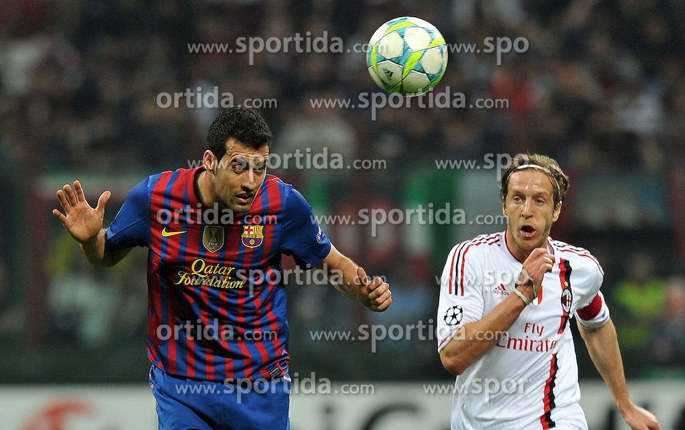 28.03.2012, Stadion Giuseppe Meazza, Mailand, ITA, UEFA CL, Viertelfinal-Hinspiel, AC Mailand (ITA) vs FC Barcelona (ESP), im Bild Massimo AMBROSINI (Milan), Sergio BUSQUETS (Barcellona) // during the UEFA Champions League Quarter-final first leg Match between AC Mailand (ITA) and FC Barcelona (ESP) at Giuseppe Meazza Stadium, Milan, Italy on 2012/03/28. EXPA Pictures © 2012, PhotoCredit: EXPA/ Insidefoto/ Alessandro Sabattini..***** ATTENTION - for AUT, SLO, CRO, SRB, SUI and SWE only *****