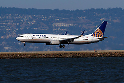 Boeing 737-924(ER) (N69888) operated by United Airlines landing at San Francisco International Airport (KSFO), San Francisco, California, United States of America