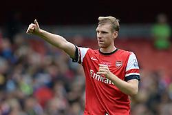 Arsenal's Per Mertesacker celebrates Arsenal winning - Photo mandatory by-line: Mitchell Gunn/JMP - Tel: Mobile: 07966 386802 22/09/2013 - SPORT - FOOTBALL - Emirates Stadium - London - Arsenal V Stoke City - Barclays Premier League