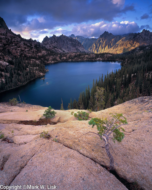 Storm clouds blow over Baron Lake and strugle to clear the giant peaks of the Sawtooth mountains, Idaho.