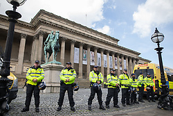 © Licensed to London News Pictures . 03/06/2017 . Liverpool , UK . Hundreds of police manage a demonstration by the far-right street protest movement , the English Defence League ( EDL ) and an demonstration by opposing anti-fascists , including Unite Against Fascism ( UAF ) . Photo credit: Joel Goodman/LNP