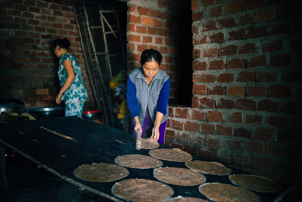 Women make rice pancakes at a small village house in the Hoi An countryside, in central Vietnam.