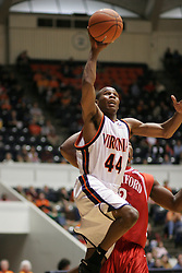 Sean Singletary (44) goes up for a shot against Hartford.  Singeltary had a game high 22 points to lead UVA to a 71-62 victory in Charlottesville...The Virginia Cavaliers defeated the Hartford Hawks 71-62 at University Hall in Charlottesville, VA on December 31, 2005.