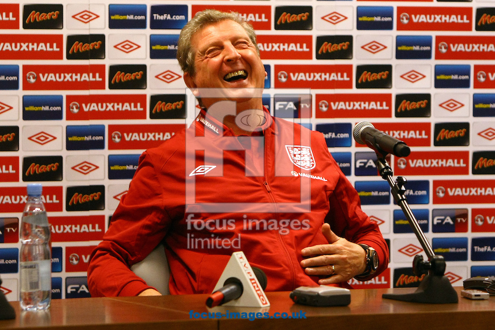 Picture by Paul Chesterton/Focus Images Ltd +44 7904 640267.15/10/2012.England manager Roy Hodgson and Steven Gerrard of England during the press conference ahead of the 2014 FIFA World Cup Qualifying match at the National Stadium, Warsaw.