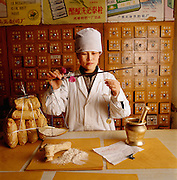 "Chinese apothecaries, like this one in Beijing, still sell ground-up dinosaur bone for pharmaceutical purposes.  ""Stone dragon bones"" are believed to have the power to cure a variety of ailments."