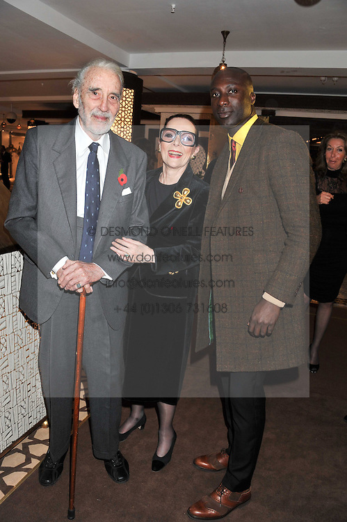 Left to right, actor SIR CHRISTOPHER LEE, his wife BIRGIT and designer OZWALD BOATENG at the Inspiring Morocco launch held at Harrods, Knightsbridge, London on 3rd November 2011.