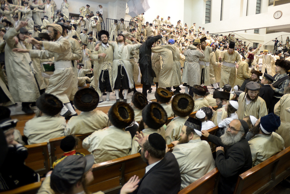 JERUSALEM, ISRAEL - MARCH 17, 2014: Ultra-Orthodox Jewish men of the Toldot Aharon Sect celebrate the Purim holiday in the ultra-orthodox Mea Shearim neighborhood in Jerusalem on March 17, 2014. The festival of Purim commemorates the rescue of Jews from a genocide in ancient Persia. Photo by Gili Yaari