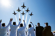 Class of 2015 cheers as the Navy Blue Angles fly over Navy-Marine Corps Memorial Stadium in Annapolis during the Graduation/Commissioning Ceremony at the United States Naval Academy on Friday May 22, 2015. (Alan Lessig/Staff)
