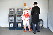 © Licensed to London News Pictures. 17/06/2014. Ascot, UK. People get cash from from the mobile ATMs.  Day one at Royal Ascot 17th June 2014. Royal Ascot has established itself as a national institution and the centrepiece of the British social calendar as well as being a stage for the best racehorses in the world. Photo credit : Stephen Simpson/LNP