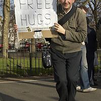 Man holding a Free Hug sign at the Speaker's corner, Hyde Park, London