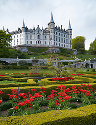 View of Dunrobin Castle and gardens on the North Coast 500 scenic driving route in northern Scotland, UK