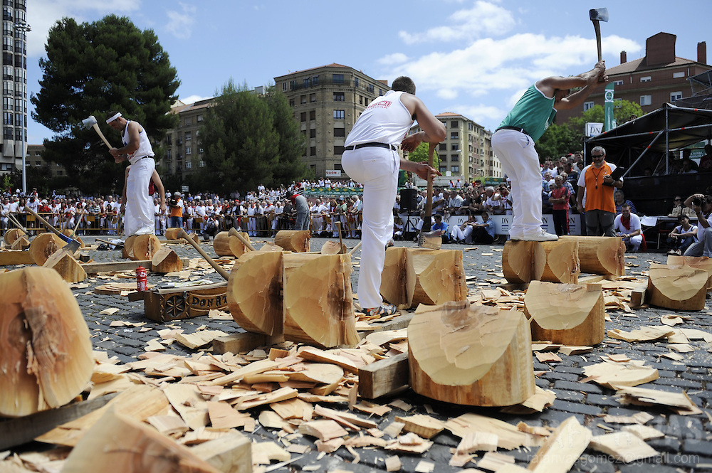 An aizkolari (woodchopper in Basque) chops a tree trunk during a rural Basque sports championship, on July 8, 2012, during San Fermin Festival, in the Northern Spanish city of Pamplona. PHOTO / Rafa Rivas