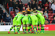 Norwich City players huddle before the EFL Sky Bet Championship match between Middlesbrough and Norwich City at the Riverside Stadium, Middlesbrough, England on 30 March 2019.