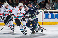 KELOWNA, CANADA - APRIL 22: Donovan Neuls #19 of Seattle Thunderbirds checks Rodney Southam #17 of Kelowna Rockets on April 22, 2016 at Prospera Place in Kelowna, British Columbia, Canada.  (Photo by Marissa Baecker/Shoot the Breeze)  *** Local Caption *** Donovan Neuls; Rodney Southam;