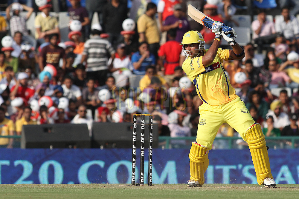 Murali Vijay of the Chennai Super Kings square drives a delivery towards the boundary during match 9 of the Indian Premier League ( IPL ) Season 4 between the Kings XI Punjab and the Chennai Super Kings held at the PCA stadium in Mohali, Chandigarh, India on the 13th April 2011..Photo by Shaun Roy/BCCI/SPORTZPICS