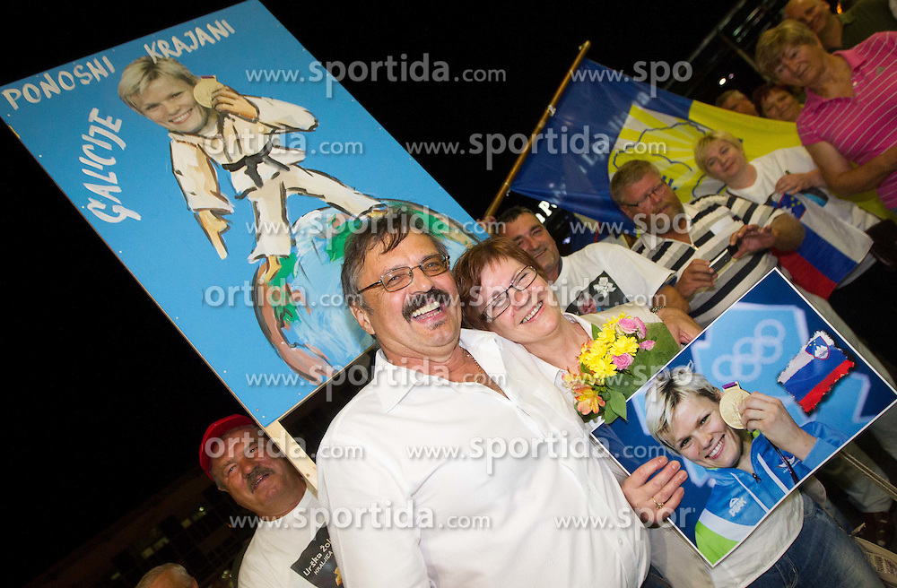 Urska Zolnir parents Ljubo and Majda during reception of Slovenian Olympic team, on August 5, 2012 in Airport Joze Pucnik, Brnik, Slovenia. (Photo by Vid Ponikvar / Sportida.com)