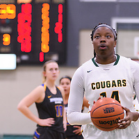 1st year post Angela Bongomin (14) of the Regina Cougars in action during the Women's Basketball Preseason game on October 6 at Centre for Kinesiology, Health and Sport. Credit: Arthur Ward/Arthur Images