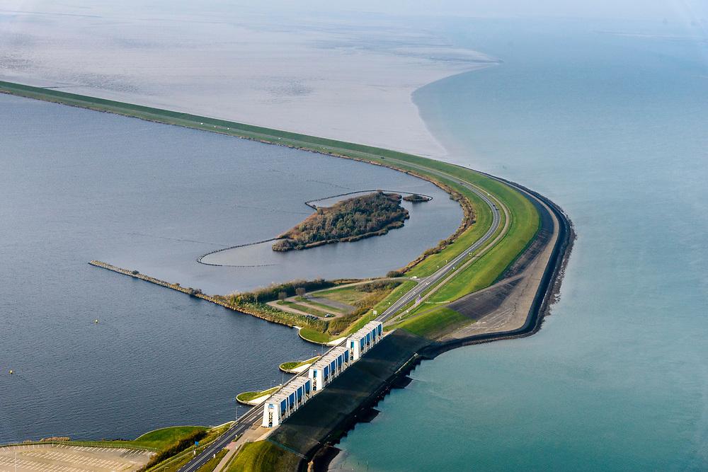 Nederland, Friesland, Groningen, Lauwersoog, 04-11-2018; Lauwersmeer op de grens van Groningen en Friesland, afsluitdijk van de Lauwerszee. In de dijk spuisluizen naar Waddenzee, de R.J. Cleveringsluizen. <br /> Lauwersmeer on the border between Groningen and Friesland, the dike of the Lauwers sea.<br /> luchtfoto (toeslag op standaard tarieven);<br /> aerial photo (additional fee required);<br /> copyright © foto/photo Siebe Swart