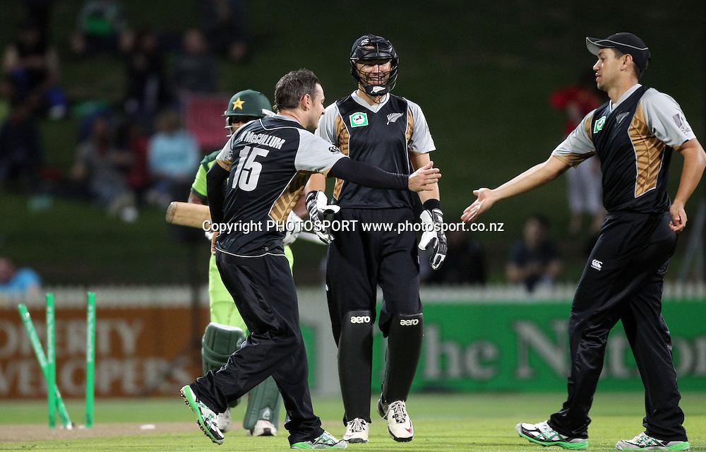 New Zealand bowler Nathan  McCullum celebrates bowling Asad Shafiq. New Zealand Black Caps v Pakistan, Match 2. Twenty 20 Cricket match at Seddon Park, Hamilton, New Zealand. Tuesday 28 December 2010. Photo: Andrew Cornaga/photosport.co.nz
