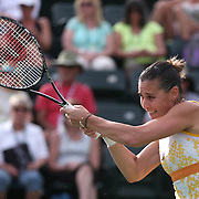 March 11, 2014. Indian Wells, California. Flavia Pennetta defeats Camila Giorgi in the fourth round of the 2014 BNP Paribas Open. (Photo by Billie Weiss/BNP Paribas Open)