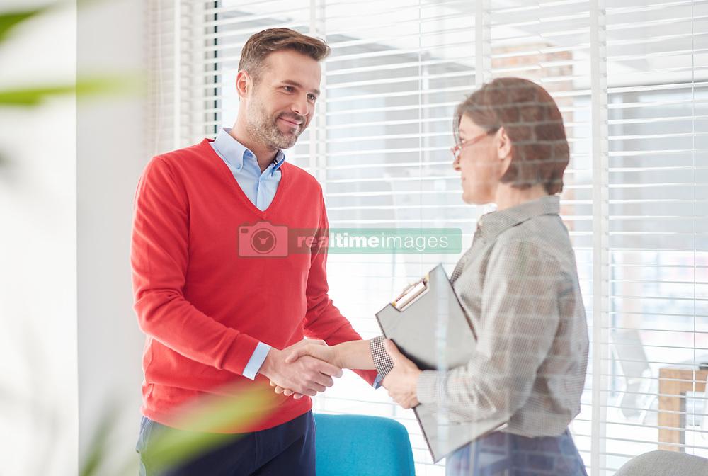 January 4, 2017 - Man shaking hands at job interview (Credit Image: © Image Source via ZUMA Press)