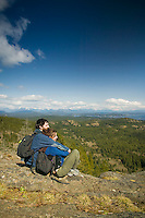 Hikers atop Chinese Mountain on Quadra Island are rewarded with a beautiful view overlooking Quadra Island and the Discovery Islands.  Quadra Island, British Columbia, Canada.