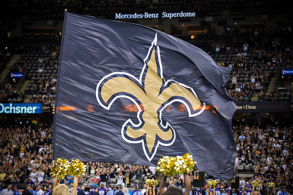 NEW ORLEANS, LA - SEPTEMBER 21:  Flag of the New Orleans Saints is run onto the field before a game against the Minnesota Vikings at Mercedes-Benz Superdome on September 21, 2014 in New Orleans, Louisiana.  The Saints defeated the Vikings 20-9.  (Photo by Wesley Hitt/Getty Images) *** Local Caption ***