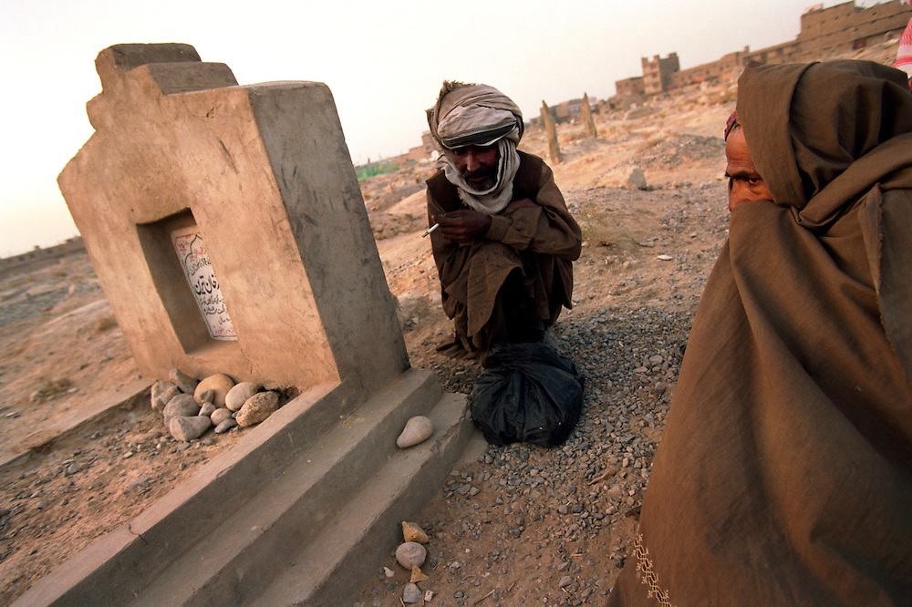 Drug addicts in a cemetary where they live and use heroin.  Many of the addicts are Afghan refugees.  Afghanistan is the worlds largest poppy producing nation and exports opium and heroin to its neighbors as well as to the rest of the world..Quetta, Pakistan.  14 October 2001.Photo © J.B. Russell