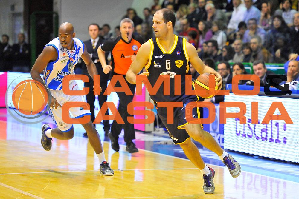 DESCRIZIONE : Campionato 2013/14 Dinamo Banco di Sardegna Sassari - Sutor Montegranaro<br /> GIOCATORE : Zeliko Sakic<br /> CATEGORIA : Palleggio Contropiede<br /> SQUADRA : Sutor Montegranaro<br /> EVENTO : LegaBasket Serie A Beko 2013/2014<br /> GARA : Dinamo Banco di Sardegna Sassari - Sutor Montegranaro<br /> DATA : 30/03/2014<br /> SPORT : Pallacanestro <br /> AUTORE : Agenzia Ciamillo-Castoria / Luigi Canu<br /> Galleria : LegaBasket Serie A Beko 2013/2014<br /> Fotonotizia : Campionato 2013/14 Dinamo Banco di Sardegna Sassari - Sutor Montegranaro<br /> Predefinita :