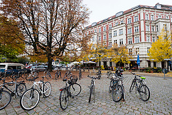 Bicycles parked at Rykestrasse in bohemian Prenzlauer Berg in Berlin Germany
