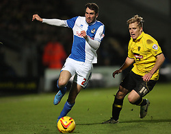 Bristol Rovers' Michael Smith gets past Burton Albion's Damien McCrory- Photo mandatory by-line: Matt Bunn/JMP - Tel: Mobile: 07966 386802 23/11/2013 - SPORT - Football - Burton - Pirelli Stadium - Burton Albion v Bristol Rovers - Sky Bet League Two