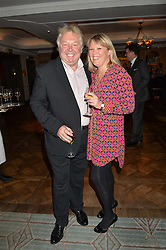NICK FERRARI and CLARE PATTERSON at a party hosted by Ewan Venters CEO of Fortnum & Mason to celebrate the launch of The Cook Book by Tom Parker Bowles held at Fortnum & Mason, 181 Piccadilly, London on 18th October 2016.