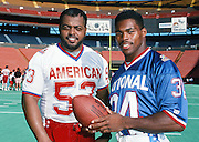 American Football Conference Indianapolis Colts linebacker Ray Donaldson (53) poses for a photo with National Football Conference Dallas Cowboys running back Herschel Walker (34) at photo day during the week before the 1989 NFL Pro Bowl football game against the National Football Conference on Jan. 24, 1989 in Honolulu. The NFC won the game 34-3. (©Paul Anthony Spinelli)