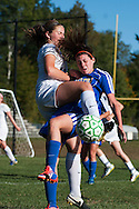 Milton's Carlie Reen (5) collides with Rice's Margot Rathke (19) during the girls soccer game between the Milton Yellowjackets and the Rice Green Knights at Rice Memorial High School on Saturday afternoon October 3, 2015 in South Burlington. (BRIAN JENKINS/ for the FREE PRESS)