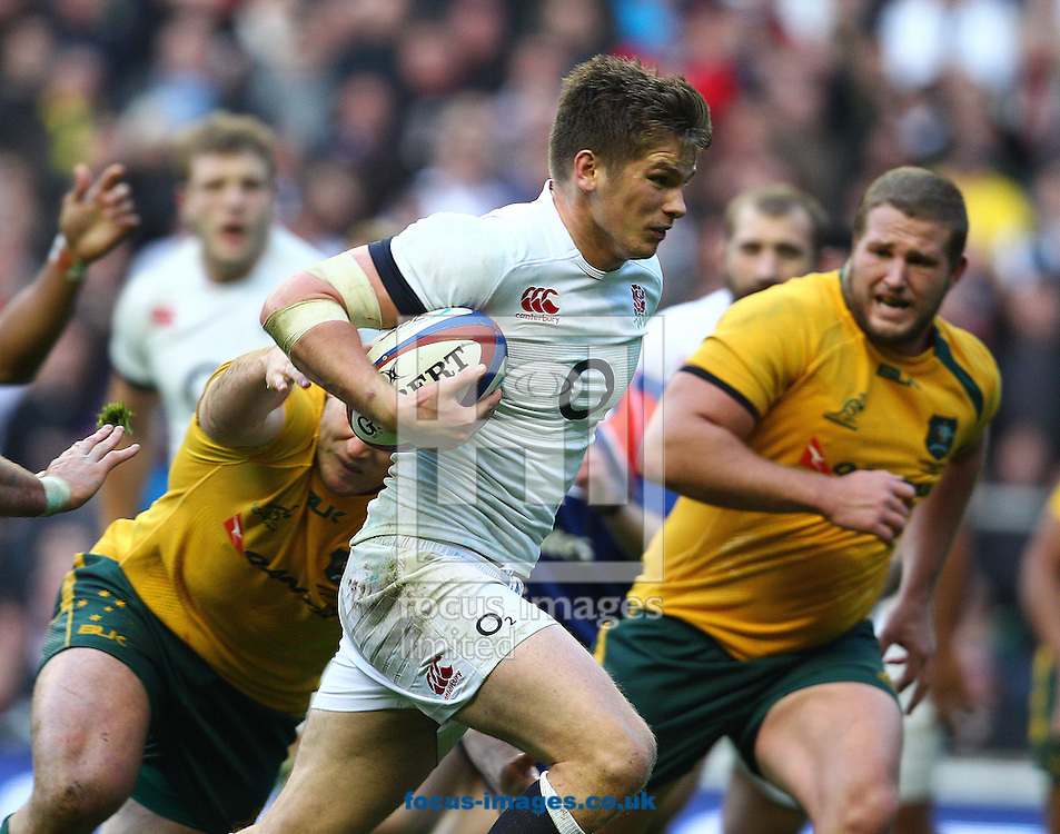 Picture by Paul Terry/Focus Images Ltd +44 7545 642257<br /> 02/11/2013<br /> Owen Farrell of England breaks free from the Australia defence on his way to scoring a try during the QBE Internationals  match at Twickenham Stadium, Twickenham.