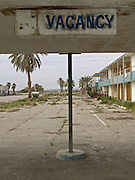 entrance no vacancy sign by an abandoned hotel USA