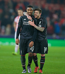 STOKE-ON-TRENT, ENGLAND - Tuesday, January 5, 2016: Liverpool's goal-scorer Jordon Ibe celebrates with Alberto Moreno after the 1-0 victory over Stoke City during the Football League Cup Semi-Final 1st Leg match at the Britannia Stadium. (Pic by David Rawcliffe/Propaganda)