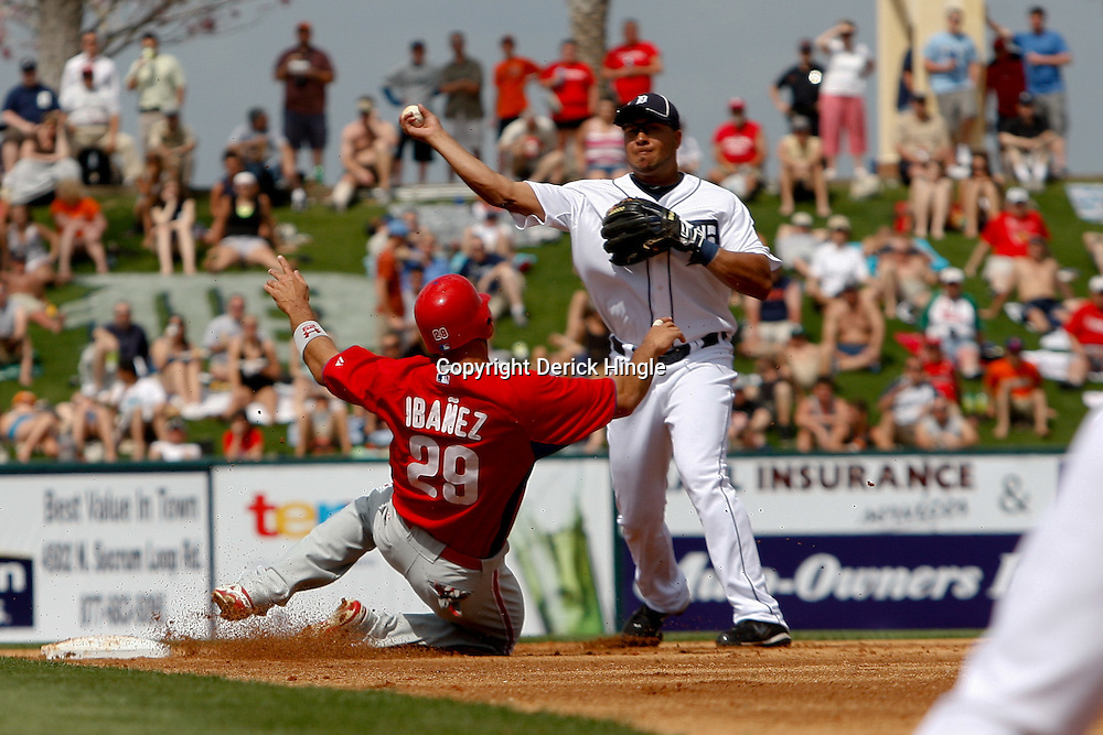 March 9, 2011; Lakeland, FL, USA; Detroit Tigers shortstop Jhonny Peralta (27) forces out Philadelphia Phillies left fielder Raul Ibanez (29) and completes a double play during a spring training exhibition game at Joker Marchant Stadium.  Mandatory Credit: Derick E. Hingle
