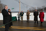 Athens Mayor Paul Wiehl and Ohio University President Roderick J. McDavis prepare to cut a ribbon to signify the official opening of South Green Drive on Jan. 7. 2015. Photo by Lauren Pond