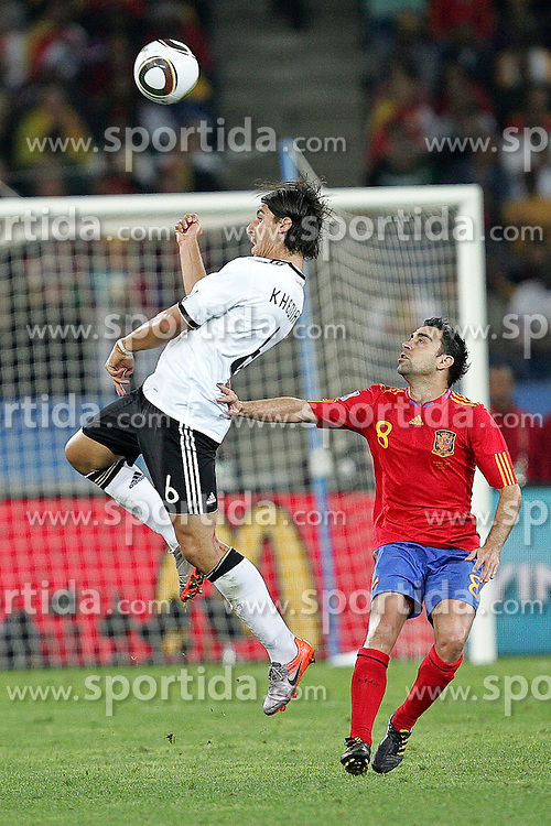 07.07.2010, Moses Mabhida Stadium, Durban, SOUTH AFRICA, Deutschland ( GER ) vs Spanien ( ESP ) im Bild Sami Khedira of Germany and  Xavi of Spain.Foto ©  nph /  Kokenge / SPORTIDA PHOTO AGENCY