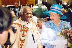 Queen Elizabeth II talks with Archbishop Desmond Tutu as she leaves St George's Cathedral in Cape Town, after attending a service to mark Human Rights Day.