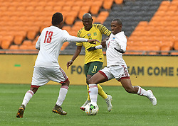 South Africa: Johannesburg: Bafana Bafana player Aubrey Modiba battle for the ball with Seychelles players Colin Esthe(L)r and Colin Bibi(R) during the Africa Cup Of Nations qualifiers at FNB stadium, Gauteng.<br />