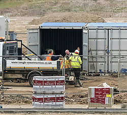 Construction Workers During Coronavirus Outbreak, 25 March 2020<br /> <br /> The Scottish Government has advised that construction sites should close and is currently developing guidance for business on how to respond, and how to confirm whether their activities are essential or non-essential.<br /> <br /> First minister Nicola Sturgeon said on 23 March 2020: 'This morning I was specifically asked on the radio about building sites and hair salons, and my advice would be to close.<br /> <br /> 'I want to reiterate that if you run a business, and if the nature of your business makes it difficult for you or your workers to work from home or to practice safe social distancing, then you should close for the period of the efforts to combat this virus.<br /> <br /> 'If you are an employee, and your workplace is not abiding by this, I would urge you to speak to your employer and ask that they take action.'<br /> <br /> Pictured: Construction workers on an Ashberry housing development in East Calder, Livingston can be seen at work. Some were breaching the social distancing rule of 2m and some were not wearing hard hats on the site.<br /> <br /> Alex Todd | Edinburgh Elite media