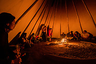 Peyote ceremony, Native American Church, water woman enters, Crow Indian Reservation, Montana