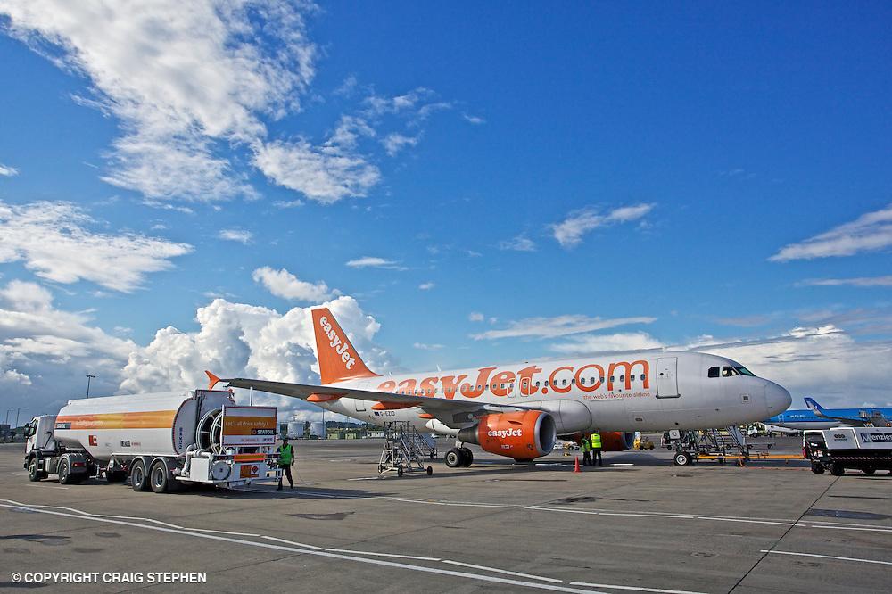 Easyjet plane refueling on the tarmac at Edinburgh airport, Scotland