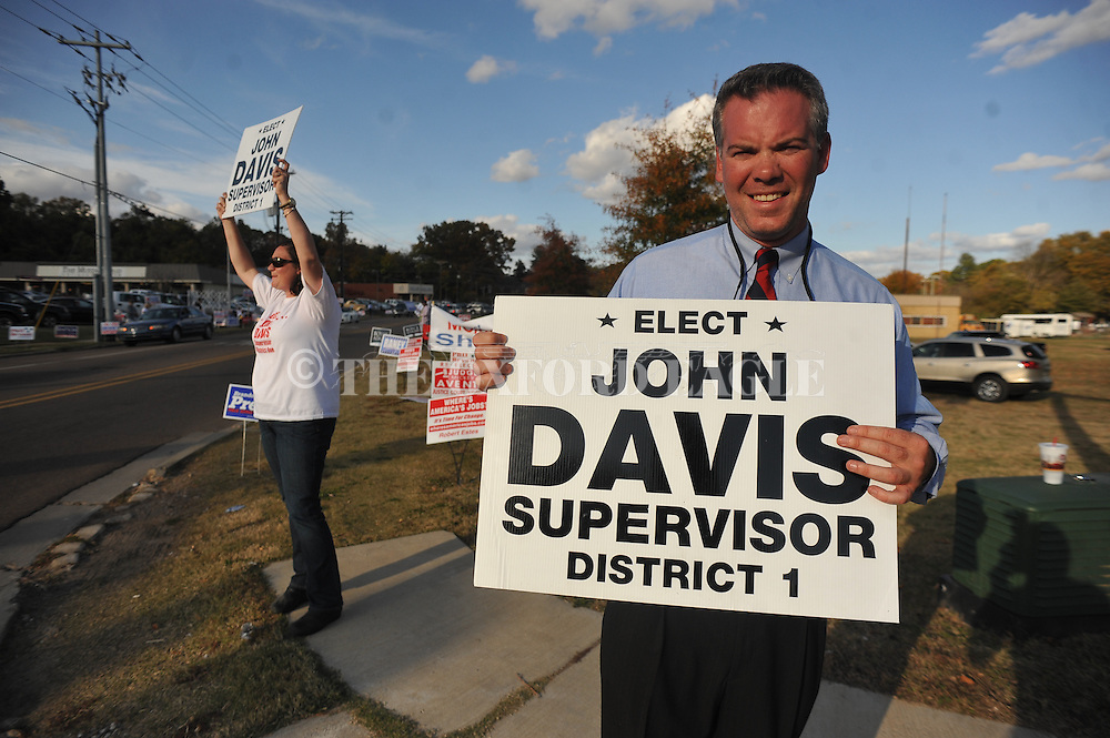 Supervisor District 1 candidate John Davis (right) and his wife Paige campaign outside the voting booths at the old National Guard Armory in Oxford, Miss. on Tuesday, November 8, 2011. Mississippians go to the polls today for state and local elections, as well as referendums including the so-called Personhood Amendment.