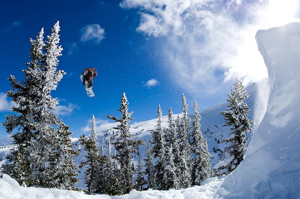Professional snowboarder Romain De Marchi snowboarding in the Coast Range Mountains of British Columbia, Canada.