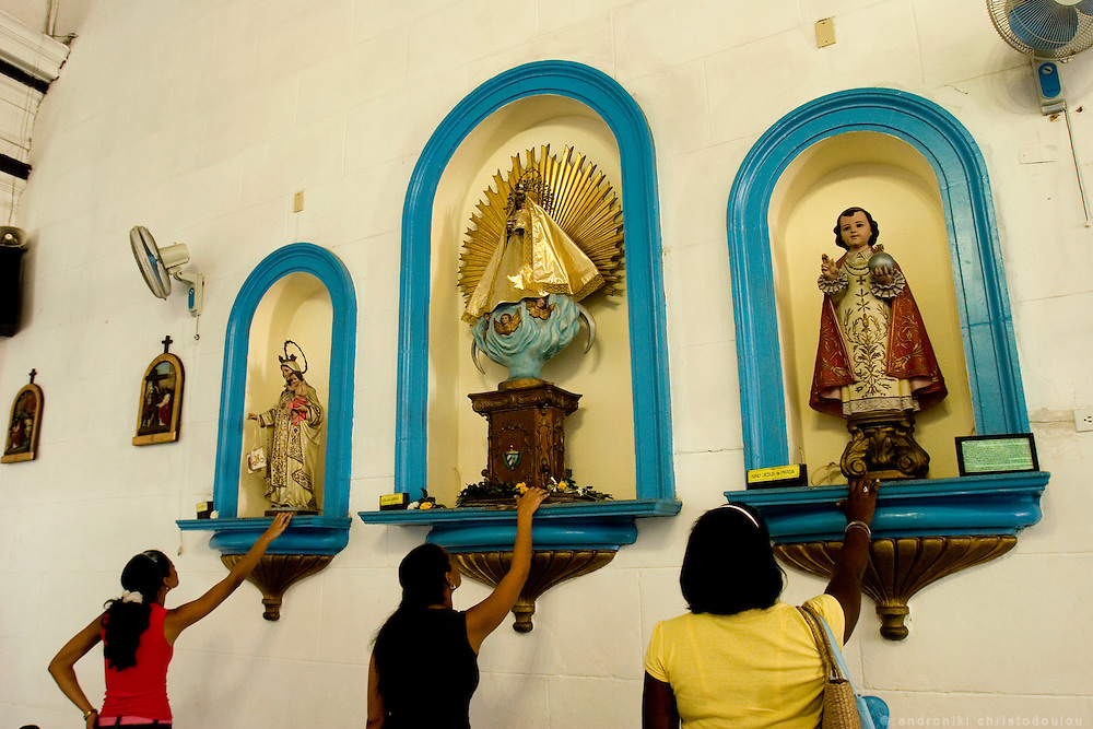 "Worshipers inside the church ""Iglesia de Nuestra Senora de Regla"". The church is located in Regla and it is associated with Santeria religion that is a mixture of Catholic and Yoruba religions. Havana - CUBA"
