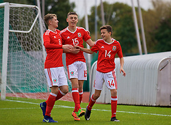 NEWPORT, WALES - Sunday, September 24, 2017: Wales' Owen Beck [R] celebrates scoring the first goal with team-mates William Rickard and Callum King-Harmes during an Under-16 International friendly match between Wales and Gibraltar at the Newport Stadium. (Pic by David Rawcliffe/Propaganda)